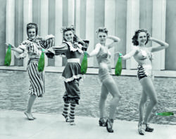 New York, New York: July 4, 1939.Four of Billy Rose´s Aquabelles stage a fashion show of the past, present and future bathing suit styles at the New York World´s Fair.